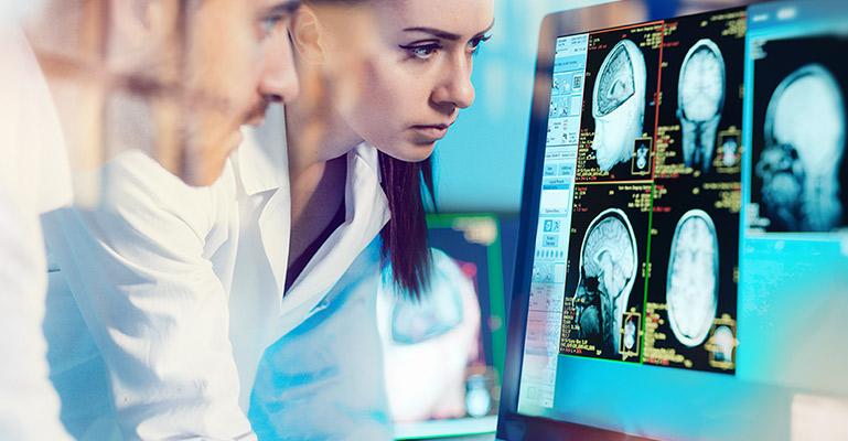 Doctors examining MRI of head